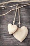 Dois corações de madeira Fotografia de Stock