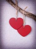 Dois corações de madeira vermelhos Imagem de Stock Royalty Free