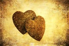 Dois corações de pedra na textura do grunge Fotos de Stock