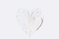Dois corações do laço do Livro Branco no fundo claro imagem de stock royalty free