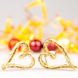 Dois corações do Natal da palha no fundo branco Fotografia de Stock