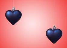 Dois corações do xmas no vermelho Imagens de Stock