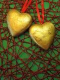 Dois corações dourados Fotografia de Stock