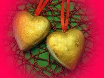 Dois corações dourados Fotos de Stock