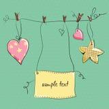 Dois corações e estrelas que penduram em uma corda Foto de Stock