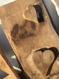 Dois corações em uma parte de madeira Imagens de Stock Royalty Free
