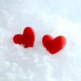 Dois corações na neve Fotografia de Stock Royalty Free