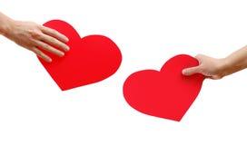 Dois corações nas mãos Foto de Stock