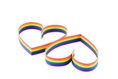Dois corações, pintura de uma bandeira do homossexual da cor. Idsolated. Fotos de Stock