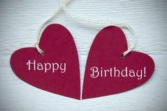 Dois corações vermelhos com feliz aniversario Imagens de Stock Royalty Free