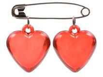 Dois corações vermelhos são juntados com um pino Foto de Stock Royalty Free