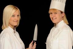 Dois cozinheiros chefe fotografia de stock