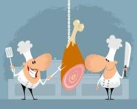 Dois cozinheiros chefe na cozinha Imagem de Stock