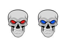 Dois crânios com os olhos azuis e vermelhos ilustração royalty free