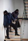 Dois criminosos em escadas Fotos de Stock Royalty Free