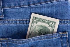 Dois dólares em um bolso das calças de brim Fotografia de Stock Royalty Free