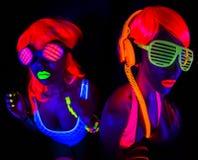 Dois dançarinos uv de néon 'sexy' do fulgor fotografia de stock