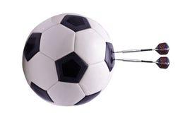 Dois dardos na esfera do futebol Fotografia de Stock Royalty Free