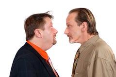 Dois desconcertaram enfrentar dos homens Fotografia de Stock