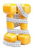 Dois dumbbells e fita de medição isolados Imagem de Stock Royalty Free