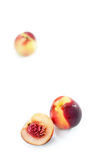Dois e meio pêssego no fundo branco Fotos de Stock Royalty Free
