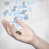 Dois euro em sua mão, símbolos de moeda no fundo Fotografia de Stock Royalty Free