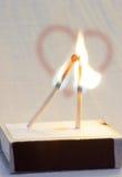 Dois fósforos ardentes Fotografia de Stock