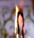 Dois fósforos na chama Imagem de Stock