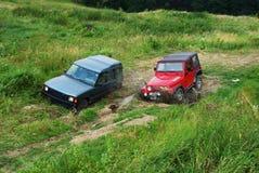Dois fora do veículo de estrada Imagem de Stock
