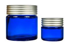 Dois frascos da nata isolados no fundo branco Imagem de Stock