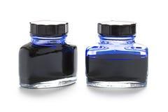 Dois frascos da tinta azul fotografia de stock royalty free