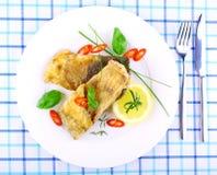 Dois fritaram faixas de peixes com fatia do limão na placa branca imagem de stock royalty free