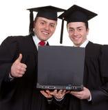 Dois graduados Fotografia de Stock Royalty Free
