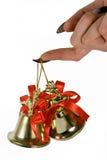 Dois handbells que penduram em um dedo Fotografia de Stock Royalty Free