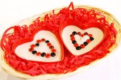 Dois handmade coração-como velas Imagens de Stock Royalty Free
