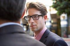 Dois homem de negócios Chatting Outside Office fotografia de stock