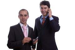 Dois homens de negócio com pilha do pda Fotografia de Stock