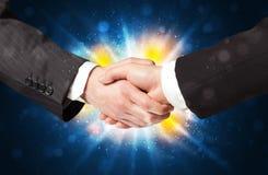 Dois homens de negócio que agitam as mãos Imagens de Stock