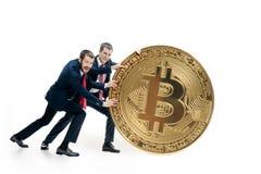 Dois homens de negócio que guardam o ícone do negócio Fotografia de Stock