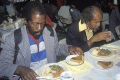 Dois homens negros que comem o Natal imagens de stock royalty free