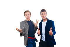 Dois homens novos consideráveis isolados no branco Fotografia de Stock