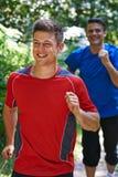 Dois homens que correm no campo junto Imagem de Stock Royalty Free