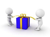 Dois indivíduos 3d que abrem um presente Fotografia de Stock Royalty Free