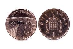 Dois ingleses uma moeda de um centavo Foto de Stock