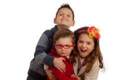Dois irmãos e irmã Fotos de Stock