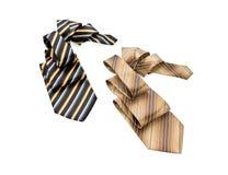 Dois listraram as gravatas dobradas na dobra Imagem de Stock