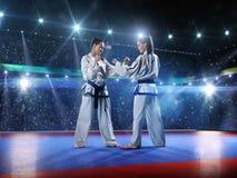 Dois lutadores fêmeas profissionais do karaté são foto de stock royalty free