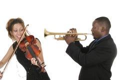 Dois músicos jogam ao redor Foto de Stock Royalty Free