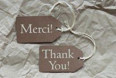 Dois meios bege de Merci das etiquetas agradecem-lhe Imagens de Stock