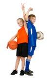 Dois meninos - jogador e jogador de futebol de basquetebol Fotografia de Stock Royalty Free
